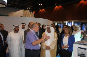 Christopher Mendoza greeting H E Dr  Abdullah Belhaif Al Nuaimi on stand