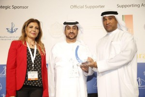 Training Centre Manager Ibrahim Bin Hraiz (R) receives conference award