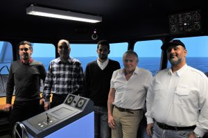 SRS course delegates and instructor in the simulator at the NMCI