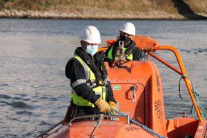 NMCI Instructors in a boat